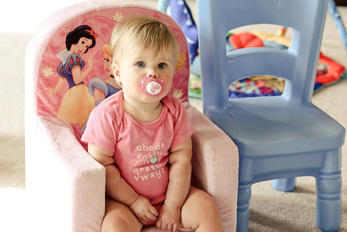 big girl sitting in the princess chair