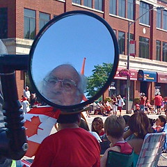 sneak peek (skintone) Tags: old blue red white canada man reflection bicycle mirror waiting crowd watching humor saturday sunny pride parade marching peek canadaday celebrate sneek walkerville lawnchairs skintone itsmulticolored wyandottestreetatkildare