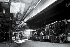 Life under the Highway (Yubai K) Tags: street old light urban blackandwhite bw streets film last dark nikon asia mood loneliness shadows market kodak decay district taiwan streetphoto lonely nikkor  nostalgie keelung streetphotos trix400 fm2n   28mmais
