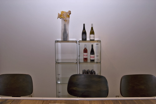 Bottles and Chairs by Damian Gadal