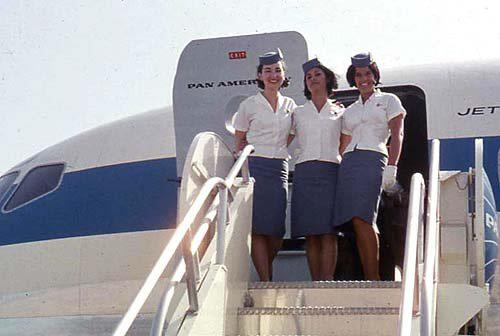 Pan Am stewardesses at top of stairwell