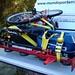 Rack com estepe, galão e bicicleta