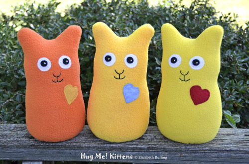Orange, gold, and lemon yellow fleece Hug Me Kittens by Elizabeth Ruffing