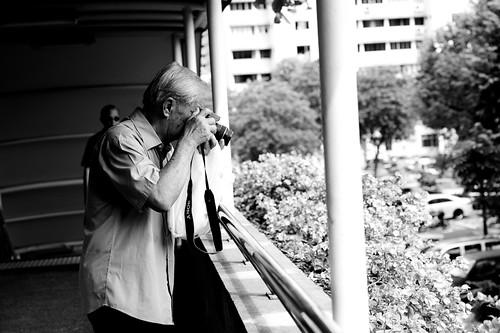 Elderly man with camera