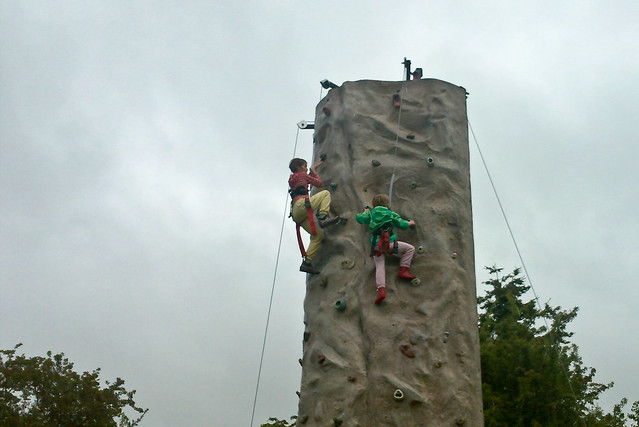 Kids climbing the rock wall