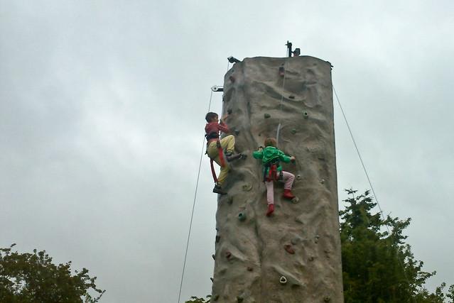 Kids climbing the rock wall