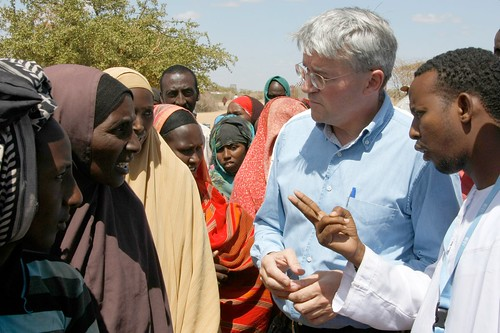 Andrew Mitchell speaks to refugees from Somalia in the Dadaab camp in northern Kenya, 16 July 2011