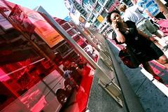red (Ian Muttoo) Tags: street red woman toronto ontario canada reflection film reflections walking lens nikon fuji angle walk cellphone gimp wideangle 200 f2 nikonf2 vivitar onthephone 21mm nikonf2photomic dp1 yongedundassquare f38 easypix filmphotographypodcast vivitar21mmf38 49000024edit
