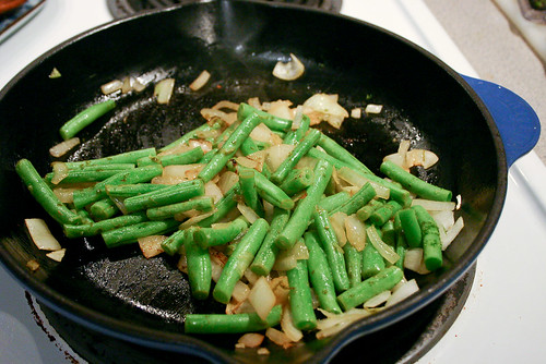 saute onions and string beans