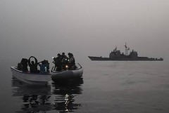 Members of a visit, board, search, and seizure team from USS Anzio intercept a skiff containing a group of suspected pirates (Official U.S. Navy Imagery) Tags: search board navy visit sailor skiff usnavy interdiction taskforce guidedmissilecruiser gulfofaden vbss intercept ussanziocg68 ctf151 combinedtaskforce151 counterpiracyoperations andseizureteam combinedmaritimeforces suspectedpirates