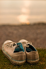 Lost and Found (Cardiff Bay) Explored (geezaweezer) Tags: water wales canon found lost 50mm bay pumps bokeh cardiff sneakers converse welsh cardiffbay converseallstars traniers