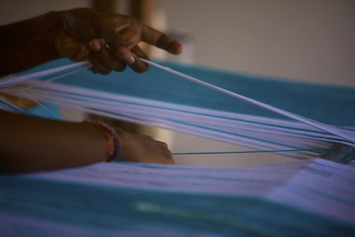detangling threads in the loom