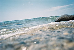 LAKE MICHIGAN, WHITEHALL (lauren s_) Tags: blue sky lake film beach nature water outside rocks waves michigan bubbles lakemichigan disposablecamera whitehall kodak400