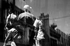 the valley of unrest (Super G) Tags: sanfrancisco california street blackandwhite bw woman man motion blur window hat shirt 50mm display doubleexposure candid tie jewelry pedestrians fareast ofcourse seafoodrestaurant