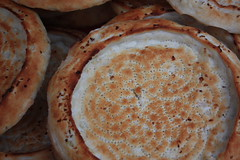 Naan Ping Chinese bread halal food muslim  Tanggu Tianjin China (Engineer J) Tags: china portrait texture bread friend market walk seed visit junaid m ping tianjin lahore naan baked rashid islamabad paksitan seasame tanggu uet engr getty:collection=fo getty:license=rf getty:id=119658116