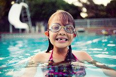 Summer 2011 (isayx3) Tags: light summer portrait water pool girl 35mm nikon child natural little teeth goggles slide f2 nikkor studios d3 2011 plainjoe isayx3 plainjoephotoblogcom