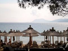 Banana beach (Wider World) Tags: sea beach umbrella mediterranean glasgow aegean fir skiathos mainland bananabeach