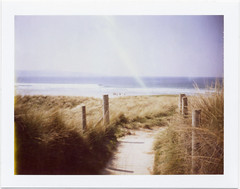 . (Rebecca...) Tags: uk winter sea film beach polaroid cornwall surf path dunes surfers godrevy landcamera peelapart 125i automatic450 flarelightleak