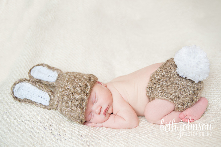 newborn baby in baby bunny hat and diaper cover