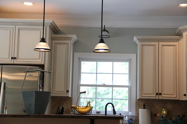 From yellow to blue a kitchen transformation unskinny boppy for Dark blue kitchen paint