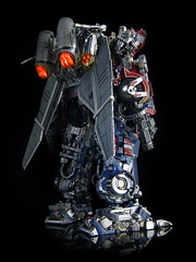 Dark of the Moon : Ultimate Optimus Prime (back 1) (frenzy_rumble) Tags: camera matrix prime transformer evil icestorm hook custom commission seeker fr convoy sunstorm autobot reflector spyglass scavenger nemesis viewfinder mixmaster decepticon scrapper lacquer kitbash shockwave artfire devastator pretender nightstick longhaul cliffjumper bonecrusher spectro combiner enamels skywarp omegasupreme targetmaster darkofthemoon thunderwing houseofkolors frenzyrumble fansproject frenzyrumblecom humanalliance procustomizers peaugh sentinalprime midwarp
