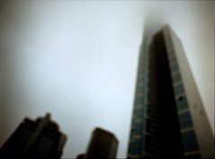pillars in the mist (mugley) Tags: city morning blue windows urban mist blur colour 120 mamiya film glass fog architecture modern buildings mediumformat prime 645 cityscape shadows skyscrapers kodak bokeh geometry stripes towers australia melbourne wideangle ibm victoria scan outoffocus southbank negative epson 6x45 vignetting esso eureka mamiya645 eurekatower urbanlandscape defocused wideopen f35 c41 portra400 kodakportra400 v700 keystoning mamiya645protl m645 hwt riversidequay nondakatsalidis newportra 35mmf35sekorn