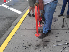 Installing the WBP RIDES bike rack (Steven Vance) Tags: road street orange wickerpark bike bicycling design wpb bicicleta transportation vlo bikerack ssa roadway dero milwaukeeavenue bikeparking bikecorral wickerparkbucktown onstreetbikeparking ssa33 bikeparkingcorral bikechi wpbrides