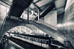 Up & Down (Philipp Klinger Photography) Tags: light shadow people urban bw white black paris france art industry lamp station metal stairs train lights nikon frankreich europa europe industrial angle metro metallic cit mtro wide descent wideangle glossy artnouveau lanterns gloss lantern railing nouveau fx deco metall philipp iledefrance ultra metalic cite descending ballustrade klinger ultrawideangle mtroparisien d700 mtrodeparis