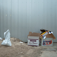 Untitled (Dr Abbate) Tags: abandoned trash fence garbage sand cardboard pile alleyway boxes laneway detritus