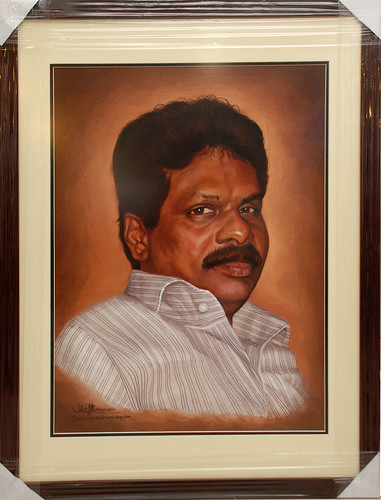 portrait painting of an Indian man in frame