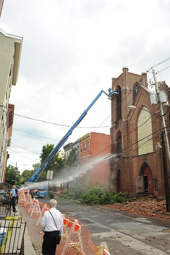 Worker attempts to demolish north tower of Trinity Church, Albany NY