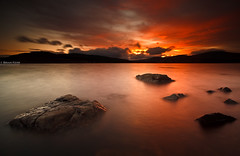 Sunset Skies (.Brian Kerr Photography.) Tags: light sunset weather clouds canon dark landscape scotland rocks skies shadows scottish loch dumfriesandgalloway clatteringshaws gallowayforest eos5dmkii