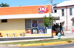 Heat got you down, go to Dairy Queen. (kennethkonica) Tags: windows summer sky people food usa white house building men green yellow standing bench outdoors women waiting open eating indianapolis fat treats fastfood indiana bbq firehydrant wires signage shorts meter shrub planter z2 dq redwhiteblue obese hoosiers customers milkshakes
