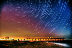 Starry Night Over the Shore (Moniza*) Tags: ocean longexposure sea sky seascape beach nature club night landscape star pier newjersey fishing nikon searchthebest nj trails explore trail shore jersey belmar jerseyshore celestial startrails polaris photooftheday northstar startrail d90 explored moniza landscapeexhibition photographerschoice~halloffame