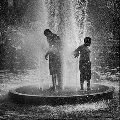 Cooling off (CVerwaal) Tags: nyc newyorkcity playing newyork water fountain kids children fun lumix washingtonsquarepark panasonic fountains heatwave coolingoff artlegacy silverefexpro panasonicg3