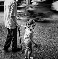 Good Daughter :: iPhone (Jonathan Kos-Read) Tags: china street blackandwhite cane beijing grandpa motionblur disabled littlegirl holdinghands    helping iphone      busystreet  verygrainy     iphoneography iphone