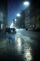 Rain (andersdenkend) Tags: blue storm green rain night dark chairs availablelight bank cobble seats artificiallight nikkor50mmf12 nikond700
