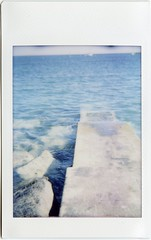 (melissafreemantle) Tags: blue summer film beach water seaside rocks dianaf seas instax instaxmini instantback