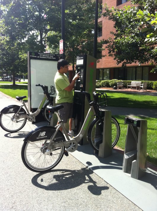 Anish Bivalkar reading up the information on the kiosk at Western Avenue