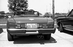 Summer Fun (Fiat 2000) (Fogel's Focus) Tags: 50mm 2000 fiat f14 wheels convertible olympus 11 d76 evanston zuiko classiccars 20c pininfarina fomapan100 jamespark om1n kodakd76 10min fomafomapan film:iso=100 developer:brand=kodak film:brand=foma developer:name=kodakd76 film:name=fomafomapan100 filmdev:recipe=6779