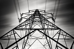 Behemoth (benjeev) Tags: longexposure blackandwhite bw tower geometric monochrome clouds power graphic transformer dramatic symmetry pylon electricity imposing towering