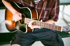 64640017 (heatherchipps) Tags: camera boy playing film canon lens 50mm hands guitar f14 instrument expired