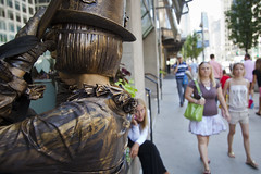 Watching the Steampunk Ringmaster Adjust Her Hat (CarusoPhoto) Tags: street city urban chicago art statue bronze canon living performance il diana 5d caruso westwood steampunk markii ringmaster ef24105mmf4lisusm johncaruso carusophoto