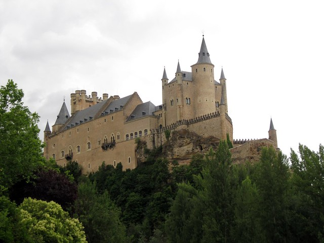 View of the Alcázar of Segovia from a grass patch below