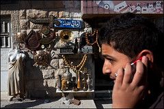 Souvenirs - Kerak, Jordan (Maciej Dakowicz) Tags: street city people mannequin shop person souvenirs call phone display middleeast jordan mobilephone souvenirshop kerak karak