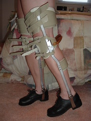 """Walking"" with Legs Fully Braced and Locked Straight (KAFOmaker) Tags: leather high shoes legs braces sandals leg bondage strap heels buckle brace straps sandal cuffs buckles restraints bracing restraint orthopedic strapped braced strapping buckled legbrace legbraces legbraced braceswithheavykneepads legbracing"