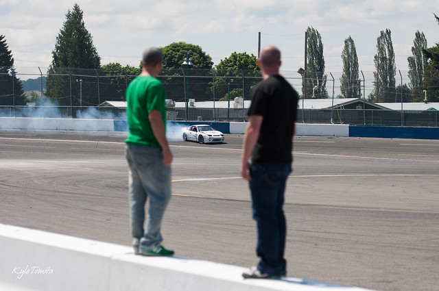 Justin Pawlak and Jason Oefelein watching Andrew Coomes drift the bank.JPG