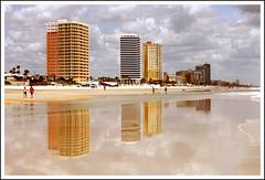Daytona Beach - Florida USA (Ralph Bos) Tags: sea sky orange usa reflection beach water yellow architecture clouds america photoshop canon buildings reflections eos mirror florida tide fl daytona ralph 500d ralphbos