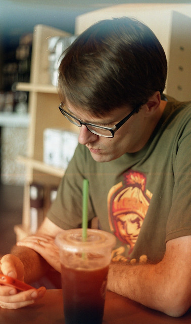 Aaron With Iced Coffee and iPhone