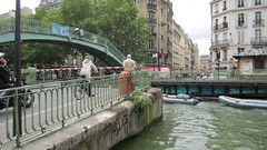 Crossing, Paris canal system (La Citta Vita) Tags: travel paris france boats europe european crossing urbanism parisian canalsaintmartin capitalcity basculebridge quaidejemmapes streetbridge lacittavita